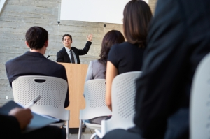 Businessman Delivering Presentation At Conference