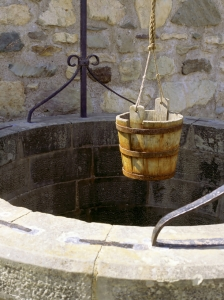 A water well with an old bucket in Fort Louisburg, Nova Scotia.