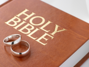 Wedding Rings Resting On A Holy Bible